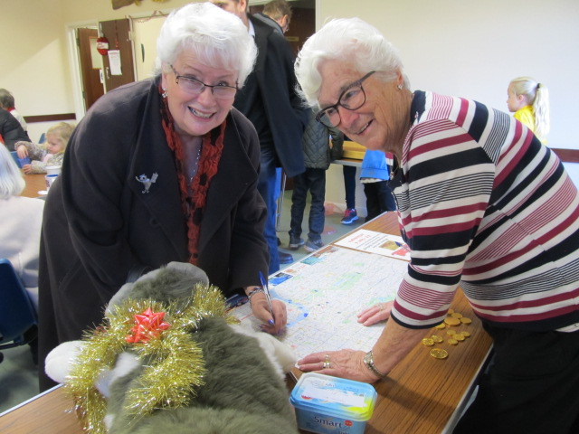 Shirley and Sally discuss strategy over the Treasure Hunt